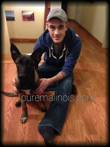 Aaron with his Belgian Malinois Puppy in Anchorage Alaska